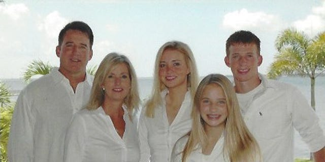 Kayleigh with her family.