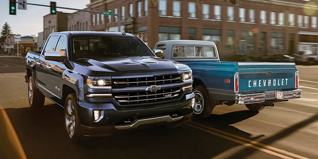 2018 Centennial Edition Silverado alongside a 1972 Chevy C10. To commemorate 100 years of Chevy trucks, the Centennial Edition Silverado offers a Centennial Blue exterior paint color, exclusive front and rear heritage bowties and 100 year door badges, available on the LTZ Z71 crew cab trim.