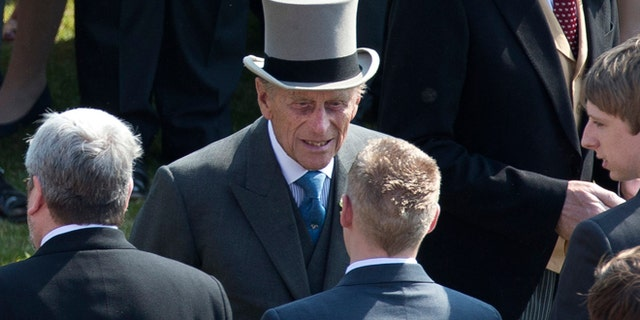 "June 6, 2013: Prince Philip, center, the husband of Britain's Queen Elizabeth II attends a garden party at Buckingham Palace in London.  Buckingham Palace says Queen Elizabeth II's husband was later admitted to a London hospital for an exploratory operation. The palace said the operation on 91-year-old Prince Philip will come after ""abdominal investigations,"" but did not elaborate.  ("