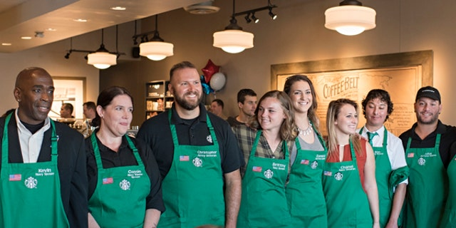 A group of newly-hired veterans pictured at a Starbucks' Military Family Store in Norfolk, Virginia.