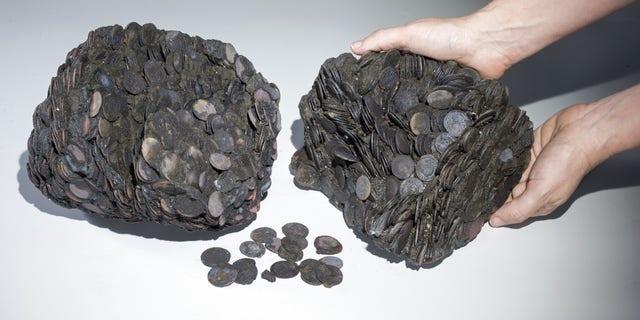Lumps of coins that were discovered at sea. (Clara Amit, courtesy of the Israel Antiquities Authority)