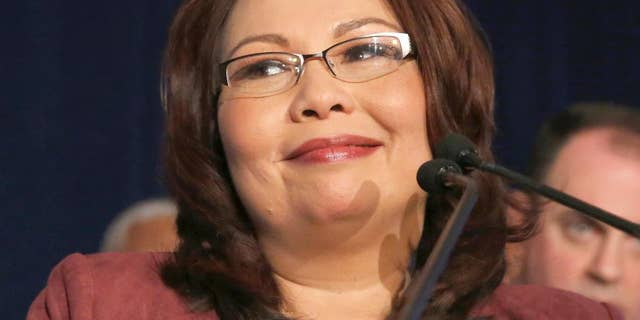 Then-Sen.-elect Tammy Duckworth, D-Ill., smiles as she celebrates her election victory in Chicago, Nov. 8, 2016.