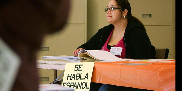 """LOS ANGELES, CA - FEBRUARY 05:  A sign reading, """"Se habla Espanol"""", identifies a bilingual election official as voters go to the polls for Super Tuesday primaries in the predominantly Latino neighborhood of Boyle Heights on February 5, 2008 in Los Angeles, California. Latinos are an increasingly important factor in California where they are expected to account for 14 percent of the vote and tend to favor presidential hopeful Sen. Hillary Clinton (D-NY) over rival Sen. Barack Obama (D-IL). At 44 million, Latinos make up15 percent of the US population, the nation's largest minority group according to the latest Census Bureau estimates.  (Photo by David McNew/Getty Images)"""