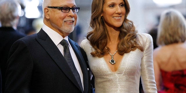 Singer Celine Dion and her husband Rene Angelil arrive at the 83rd Academy Awards at the 83rd Academy Awards in Hollywood, California, February 27, 2011.
