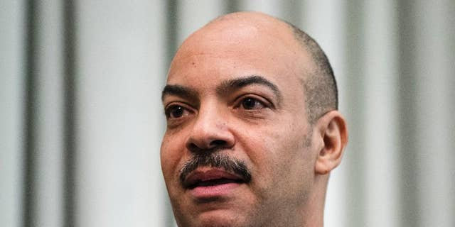 FILE - In this Feb. 10, 2017 file photo, Philadelphia District Attorney Seth Williams speaks during a news conference in Philadelphia.  Federal authorities have expanded a bribery case against Williams but say they don't plan to delay the scheduled May 31 trial. Williams remains in the $175,000-a-year job but has a deputy oversee legal matters because his law license is suspended. (AP Photo/Matt Rourke)