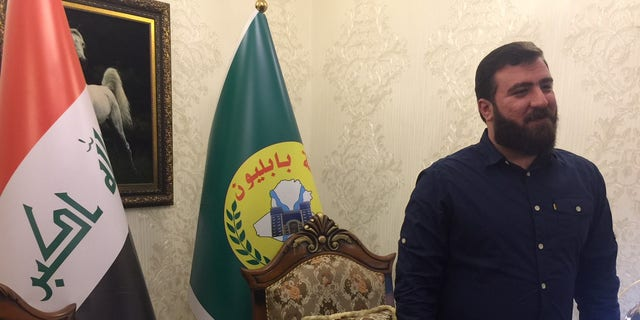 "Rayan al-Kildani, leader of the ""Babylon Brigade,"" at his Baghdad headquarters."