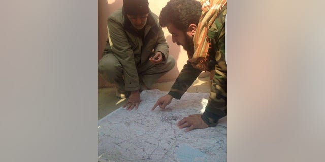 Rayan al-Kildani mapping out military maneuvers during the fight to liberate Christian areas from ISIS.