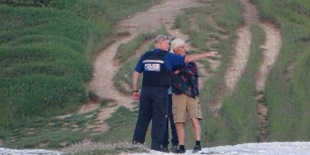 Police arrived to warn tourists to steer clear of the cliff's edge.