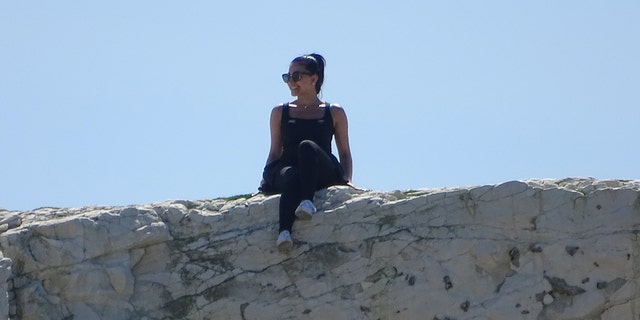 Some of the tourists, like this woman, even posed for photos while their legs were danging over the edge.