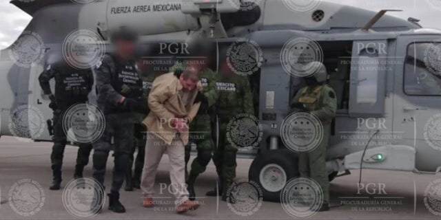 "Joaquin ""El Chapo"" Guzman is escorted by soldiers in Ciudad Juarez, Mexico, as he is extradited to New York in this handout image made available January 19, 2017."