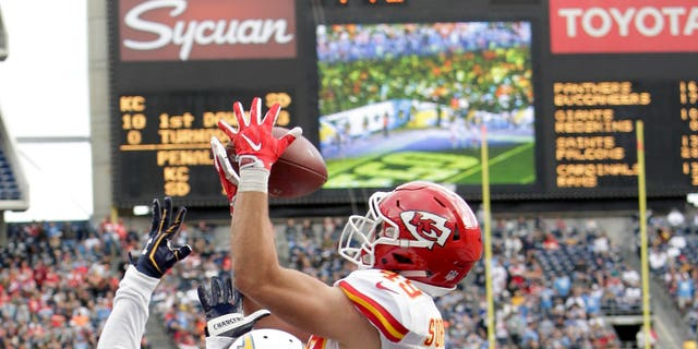 Kansas City Chiefs defensive back Daniel Sorensen, right, intercepts a pass intended for San Diego Chargers wide receiver Isaiah Burse during a football game.