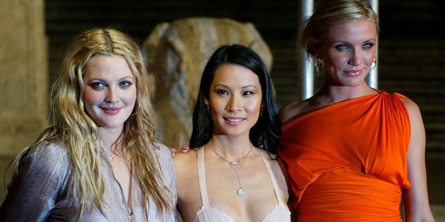 """Drew Barrymore, Lucy Lui and Diaz pose at """"Charlie's Angels"""" premiere."""