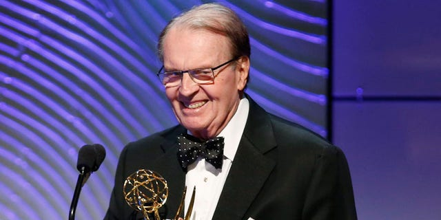 """Executive producer Rand Morrison (L) and anchor Charles Osgood of """"CBS Sunday Morning"""" accept the outstanding morning program award during the 40th annual Daytime Emmy Awards in Beverly Hills, California June 16, 2013. REUTERS/Danny Moloshok (UNITED STATES - Tags: ENTERTAINMENT) - RTX10QIY"""
