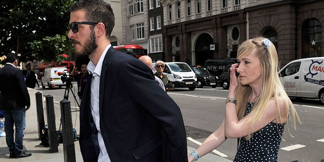 The parents of sick child Charlie Gard, Connie Yates, right, and Chris Gard, arrive at the High Court in London.