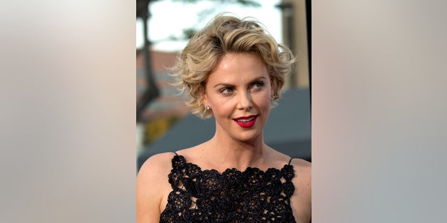 """May 15, 2014. Charlize Theron poses at the premiere of """"A Million Ways to Die in the West"""" in Los Angeles, California."""