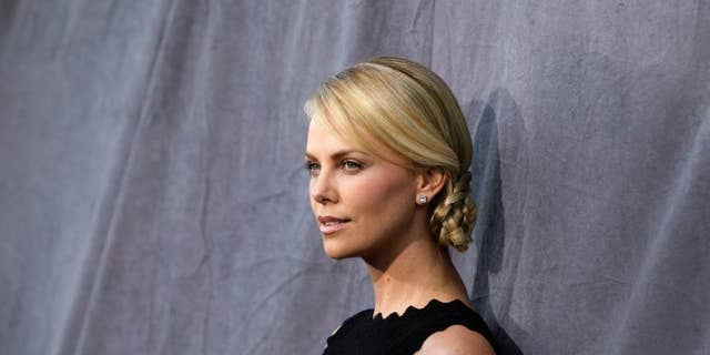 Harvey Weinstein denied through his rep that he slept with actresses Charlize Theron (pictured) and Gwyneth Paltrow.