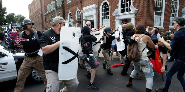 White nationalist members clashed with a group of counter-protesters in Charlottesville, Virginia, on Aug. 12, 2017.