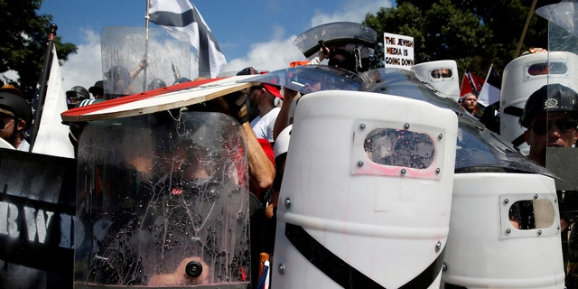 File photo - White nationalists shelter behind shields, displaying the Southern Nationalist flag, after clashing with counter protesters at a rally in Charlottesville, Virginia, U.S., Aug. 12, 2017. (REUTERS/Joshua Roberts)