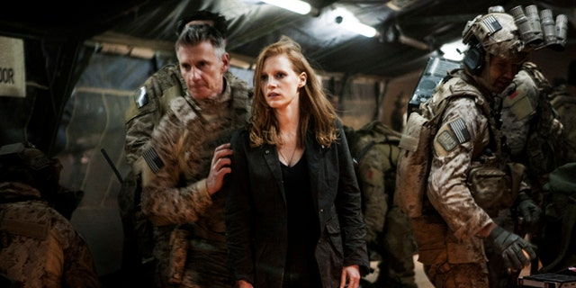 """In this undated publicity photo released by Columbia Pictures Industries, Inc., Jessica Chastain, center, plays a member of the elite team of spies and military operatives, stationed in a covert base overseas, with Christopher Stanley, left, and Alex Corbet Burcher, right, who secretly devote themselves to finding Usama Bin Laden in Columbia Pictures' new thriller, """"Zero Dark Thirty."""""""