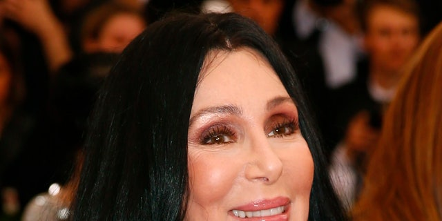 "Cher arrives at the Metropolitan Museum of Art Costume Institute Gala 2015 celebrating the opening of ""China: Through the Looking Glass,"" in Manhattan, New York May 4, 2015.   REUTERS/Lucas Jackson - RTX1BJWA"