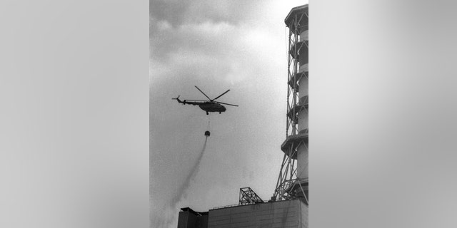 A helicopter dropping concrete onto the fourth reactor of the Chernobyl nuclear power after its explosion is seen in this 1986 file picture. (Reuters)
