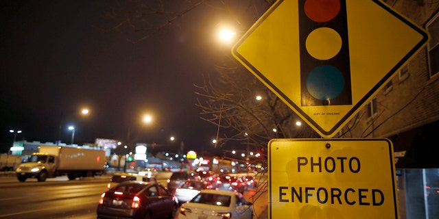 Cars approach an intersection where a red light camera is placed in Chicago, Illinois, February 9, 2015.