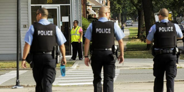 Police on patrol in Chicago. (AP Photos/M. Spencer Green)
