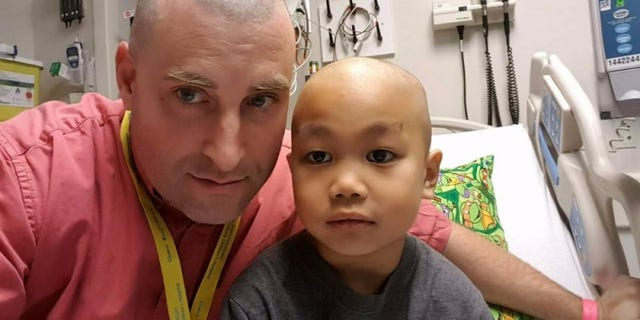 Jason and Joshua are pictured ahead of his treatment.