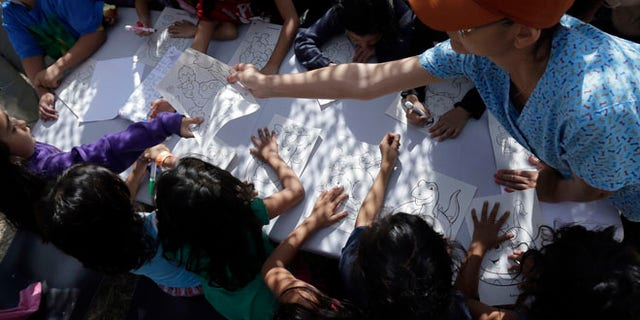 FILE: June 18, 2014: Children detainees at a U.S. Customs and Border Protection processing facility, in Brownsville, Texas.
