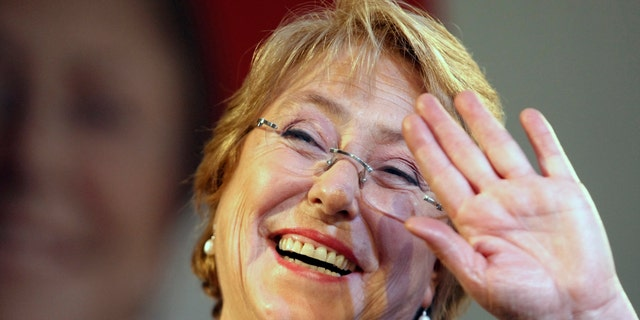 Former President Michelle Bachelet waves to supporters after winning presidential primaries in Santiago, Chile, Sunday June 30, 2013.