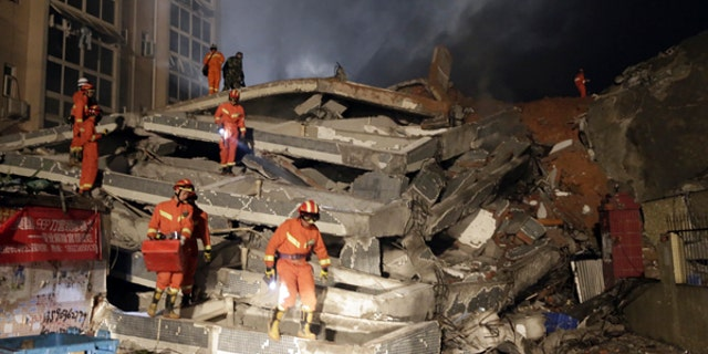 Rescuers search for survivors after a landslide in south China's Guangdong province.