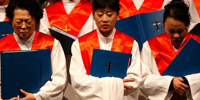 Protestants from the Nanjing Christian Church sing carols during a Christmas function in Nanjing, Jiangsu province, December 19, 2009.
