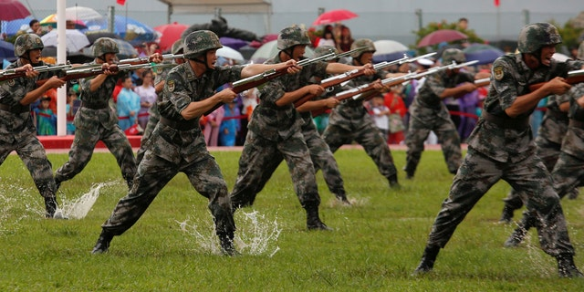 People's Liberation Army Navy soldiers perform at a naval base in Hong Kong, China July 8, 2017.