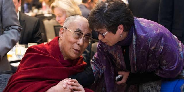 Feb. 5, 2015: Valerie Jarrett, senior adviser to President Barack Obama, right, talks with the Dalai Lama during the National Prayer Breakfast in Washington.