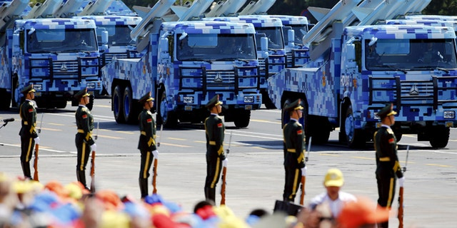 China's People's Liberation Army (PLA) navy soldiers on their armoured vehicles carrying ship-to-air missiles roll to Tiananmen Square during the military parade marking the 70th anniversary of the end of World War Two, in Beijing, China, September 3, 2015. REUTERS/Damir Sagolj - GF10000191226
