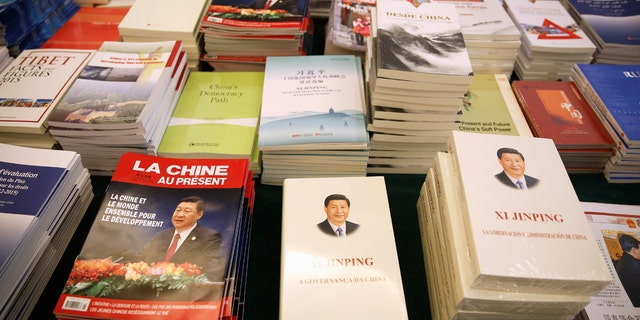 Magazines and books, featuring Chinese President Xi Jinping on the cover, are seen at the media center during the China's National People's Congress (NPC) in Beijing, March 7, 2018.