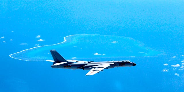 FILE - In this undated file photo released by Xinhua News Agency, a Chinese H-6K bomber patrols the islands and reefs in the South China Sea. The China Daily newspaper reported Saturday, May 19, 2018 that People's Liberation Army Air Force conducted takeoff and landing training with the H-6K bomber in the South China Sea. (Liu Rui/Xinhua via AP, File)