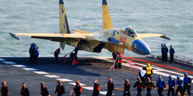 Nov. 25, 2012: This undated photo released by China's Xinhua News Agency, shows a carrier-borne J-15 fighter jet on China's first aircraft carrier, the Liaoning.