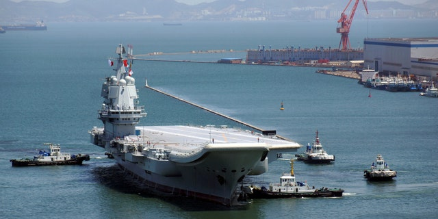 China's first domestically developed aircraft carrier is seen at a port on May 18, 2018, in Dalian after completing its first sea trials, in Liaoning province, China May 18, 2018.