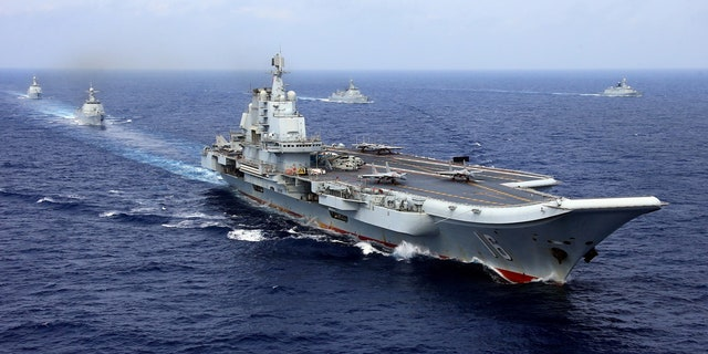 China's aircraft carrier Liaoning takes part in a military drill of Chinese People's Liberation Army (PLA) Navy in the western Pacific Ocean, April 18, 2018.