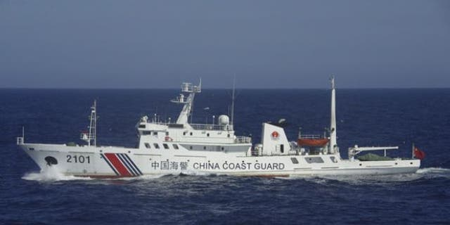 July 24, 2013: In this photo released by Japan's 11th Regional Coast Guard, a China Coast Guard ship numbered 2101 sails in waters 41 miles from the East China Sea islands called Senkaku by Japan and Diaoyu by China.