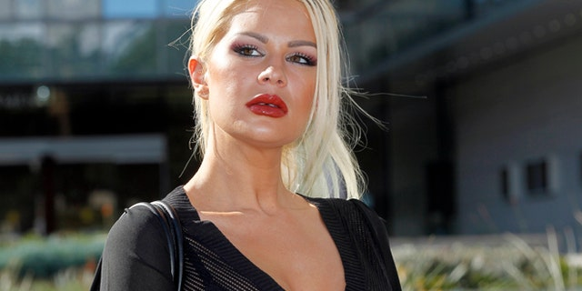 Chloe Goins, a model who claims entertainer Bill Cosby drugged and sexually abused her at the Playboy Mansion in 2008, appears before reporters outside Los Angeles police headquarters after meeting police investigators Wednesday, Jan. 14, 2015. Her attorney, Spencer Kuvin, said she came forward after hearing about other women describing abuse by Cosby and realizing she might have a valid criminal case against the comedian. (AP Photo/Nick Ut)