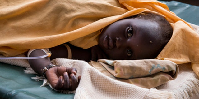 A child is treated for cholera in an isolation ward in Juba, South Sudan, on June 25, 2015. (UN Photo/JC McIlwaine)