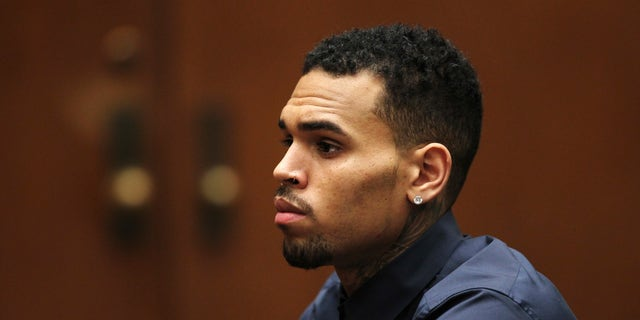 February 3, 2014. Singer Chris Brown appears for a probation progress hearing at the Clara Shortridge Foltz Criminal Justice Center in Los Angeles, California.
