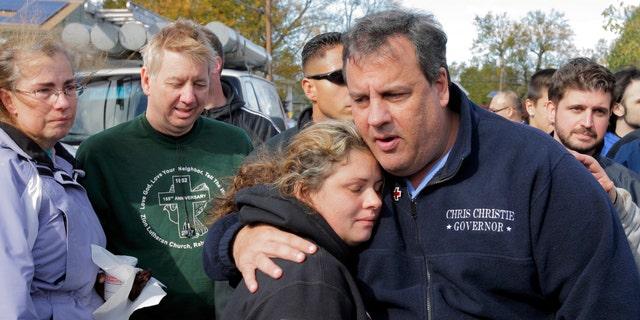 New Jersey Gov. Chris Christie comforts Kerri Berean, 33, a Chapman Street resident, in this Nov. 3, 2012 taken in Little Ferry, N.J.