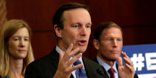 Sen. Chris Murphy, D-Conn., speaks during a news conference on Capitol Hill on October 3 to demand Congress' immediate action to reduce gun violence in the wake of the Las Vegas massacre.