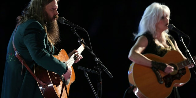 """Chris Stapleton and Emmylou Harris perform """"Wildflowers"""" during an In Memoriam tribute to Tom Petty at the 60th annual Grammy Awards at Madison Square Garden on Sunday, Jan. 28, 2018, in New York."""