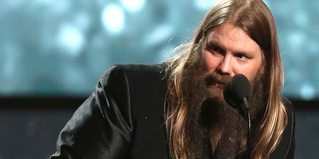 """Chris Stapleton accepts the award for best country album for """"From A Room: Volume 1"""" at the 60th annual Grammy Awards at Madison Square Garden on Sunday, Jan. 28, 2018, in New York."""