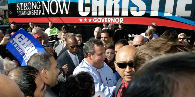 New Jersey Gov. Chris Christie, center, greets supporters during a campaign stop in Hillside, N.J., Monday, Nov. 4, 2013. Christie will face Democratic candidate, Barbara Buono in an election Tuesday, Nov. 5, 2013.