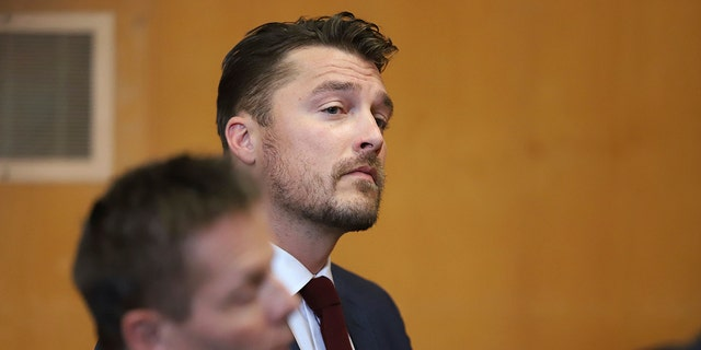 """Reality TV star Chris Soules, of """"The Bachelor,""""appears at a hearing in Buchanan County District Court with his lawyer Robert Montgomery, foreground, Thursday, Sept. 14, 2017, in Independence, Iowa. Soules is charged with leaving the scene of an April 24 crash in which he rear-ended a tractor, killing 66-year-old Kenneth Mosher. (Matthew Putney/The Courier via AP, Pool)"""